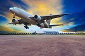 passenger jet plane landing on air port runways against beautiful dusky sky use for travel business and air transport cargo logistid service industy poster