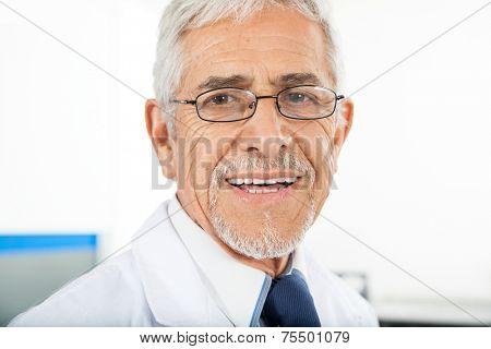 Closeup portrait of happy male technician in laboratory