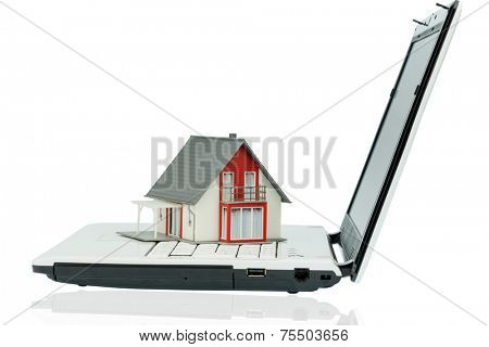 house on computertastaur, symbol photo of property and housing market in the internet