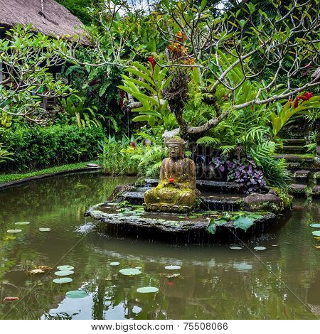 Buddha Statue On A Pond
