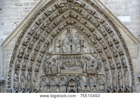 Paris - West facade of Notre Dame Cathedral. The Virgin Mary portal and tympanum