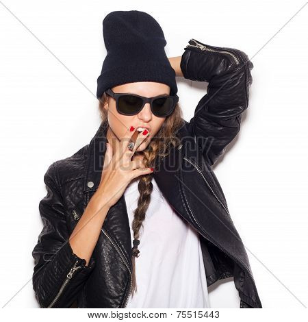 Haughty Girl In Sunglasses And Black Leather Jacket Smoking Cigar