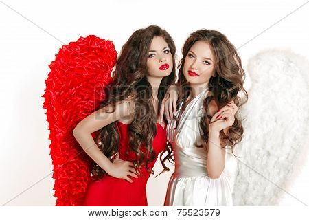 Beautiful Angel Girls With Angel's Wings. Fashion Women With Long Wavy Hair Wearing In Red And White