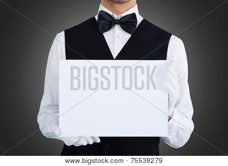 Midsection Of Waiter Holding Blank Billboard