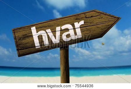 Hvar, Croacia wooden sign with a beach on background