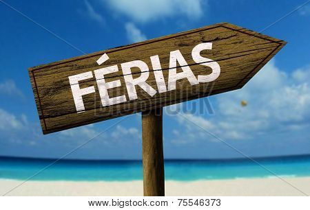 Ferias - Vacation in Portuguese - wooden sign with a beach on background