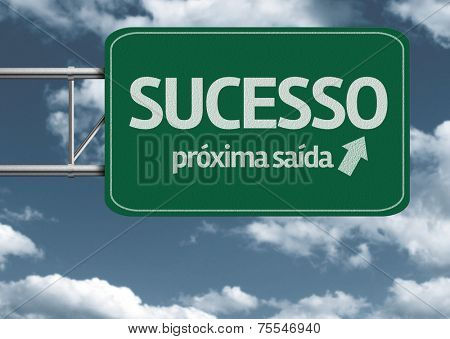 Sucesso, proxima saida (Success, next exit in portuguese) creative road sign and clouds
