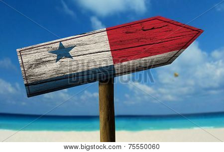 Panama wooden sign with a beach on background - Central America