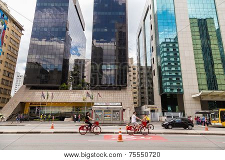 SAO PAULO, BRAZIL - October 13: Cyclists on Paulista Avenue on October 13, 2013, in Sao Paulo, Brazil. Paulista is one of the most important avenues in Sao Paulo with 2.8 kilometer.