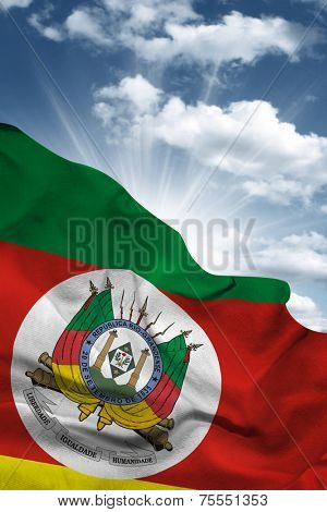 Amazing Flag of the State of Rio Grande do Sul in Brazil with a beautiful blue sky as the background - Latin America