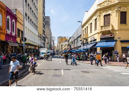 SAO PAULO, BRAZIL - OCT 24: People walks along the 25 March area in October 24, 2013 in Sao Paulo, Brazil. 25 March Area, is a popular commerce region near the center of Sao Paulo, Brazil.