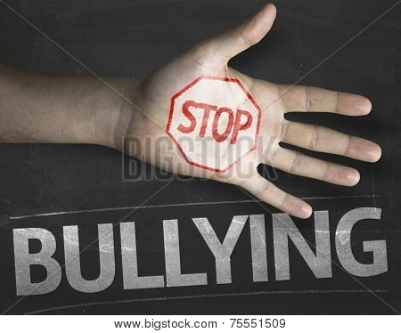 Educational and Creative composition with the message Stop Bullying on the blackboard