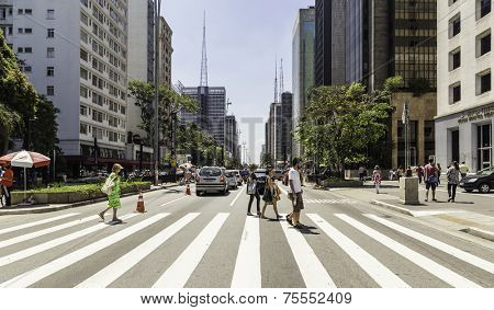 SAO PAULO, BRAZIL - NOV 10: Paulista Avenue on November 10, 2013, in Sao Paulo, Brazil. Paulista is one of the most important avenues in Sao Paulo with 2.8 kilometer of thoroughfare.