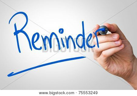 Reminder hand writing with a blue mark on a transparent board