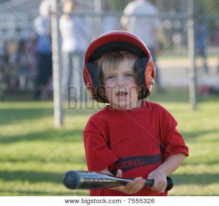 Little League Player Holding Bat