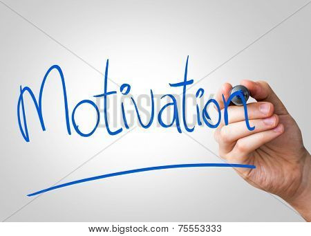 Motivation hand writing with a blue mark on a transparent board
