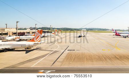 SAO PAULO, BRAZIL - NOV 16: Gol and TAM Airplanes in Guarulhos Airport on November 16, 2013 in Sao Paulo, Brazil. Guarulhos Airport is the main airport in Brazil.
