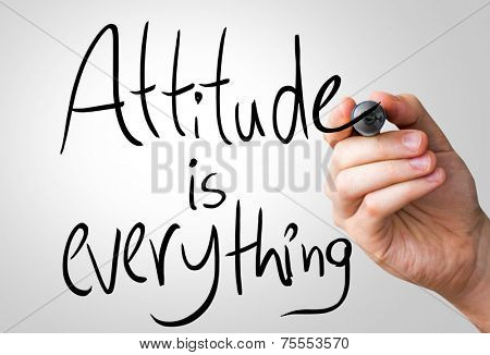Attitude is everything hand writing with a black mark on a transparent board