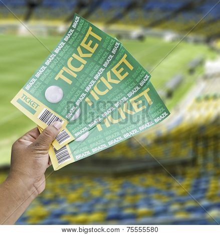Hand holds a homemade soccer tickets in the stadium - Brazil