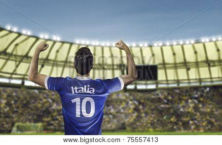 Italian soccer player celebrates with the fans on the stadium