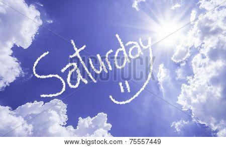 Saturday written on a beautiful sky