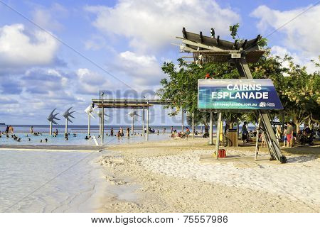 CAIRNS, AUSTRALIA - CIRCA JAN 2014 - People enjoy a hot day at Cairns Esplanade. The Cairns Esplanade is a public swimming lagoon in Cairns, Australia.