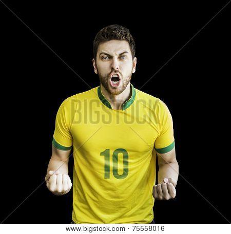 Brazilian soccer player celebrates isolated on black background