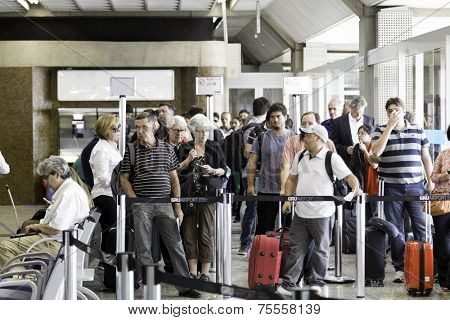 SAO PAULO, BRAZIL - CIRCA JAN 14: Passengers wait for check-in in Guarulhos Airport on in Sao Paulo, Brazil. Guarulhos is the main airport serving Sao Paulo, Brazil.