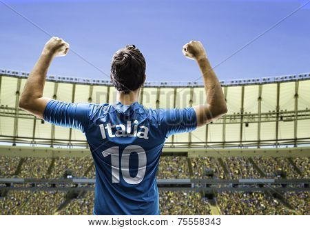 Italian soccer player celebrates on the stadium with the fans