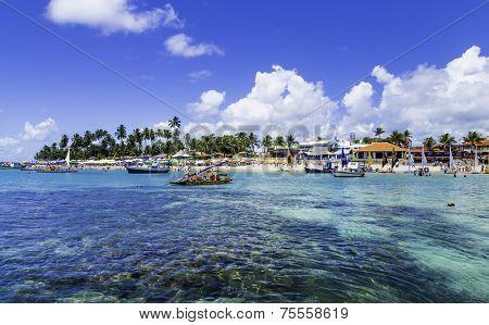 PORTO DE GALINHAS, BRAZIL - CIRCA JAN 2014 - Jangada cross the Barrier reef in Porto de Galinhas, Recife, Pernambuco - Brazil