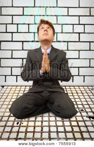 Comic Businessman On Knees Praying