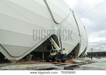 MANAUS, BRAZIL - CIRCA MARCH 2014: Engineers construct the Arena Manaus in Manaus, Brazil. The Arena is one of the stadiums for the World Cup.