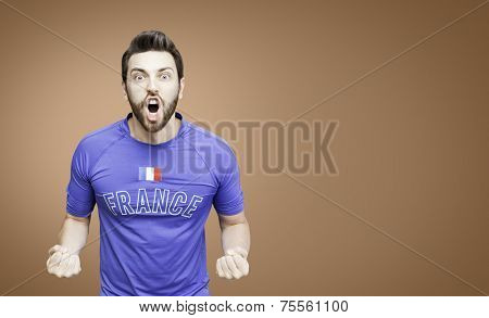 French soccer player celebrates on red background
