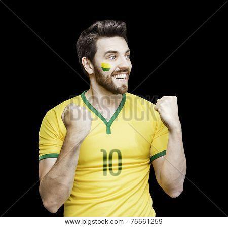 Brazilian fan celebrates on the black background