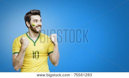 Brazilian fan celebrates on the blue background