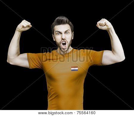 Dutchman soccer player celebrates on black background