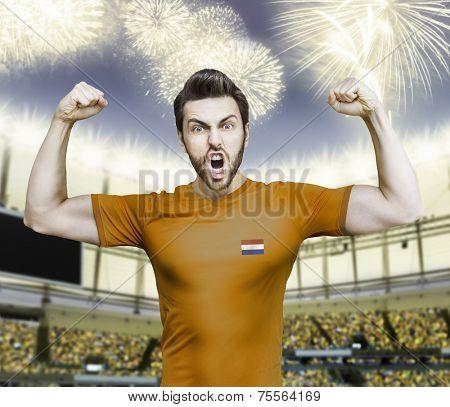 Dutchman soccer player celebrates on the stadium