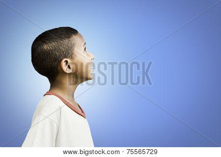 American little boy on blue background