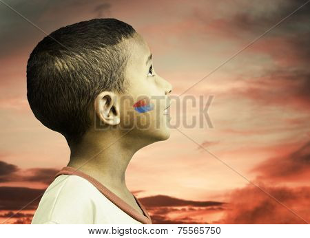 American little boy looks to the beautiful sky