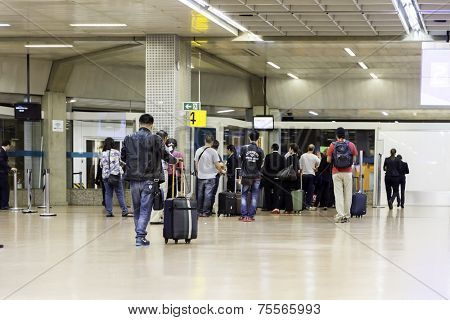 SAO PAULO, BRAZIL - CIRCA JUN 2014: Passengers at Guarulhos Airport in Sao Paulo, Brazil. Guarulhos is the main airport serving Sao Paulo, Brazil.