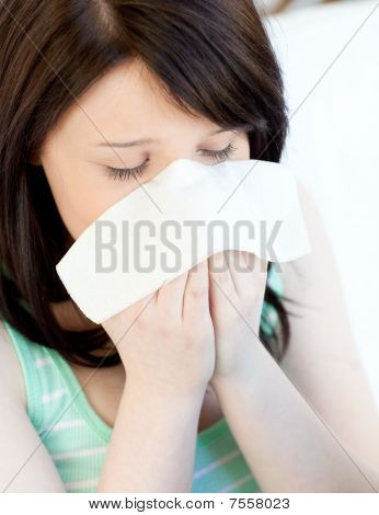 Portrait Of A Sick Tired Teen Girl Blowing
