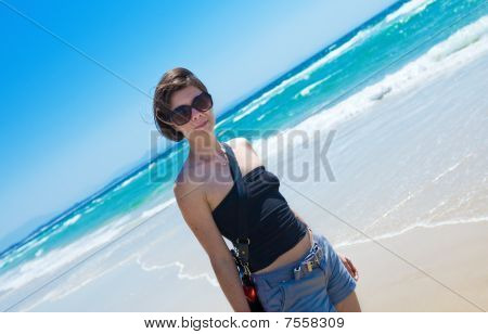 Brunette On A Sun Drenched Beach