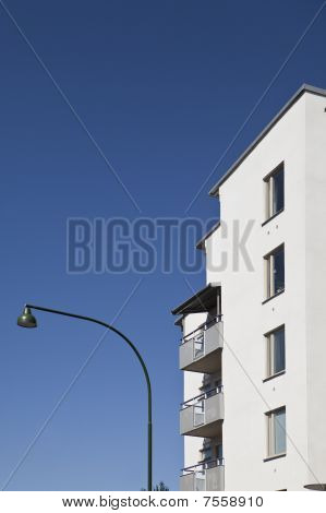 Modern building and a lamp towards blue sky poster