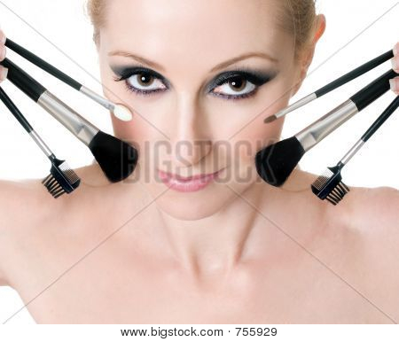 Female Face With Cosmetic Makeup Brushes
