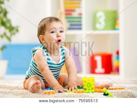 kid boy playing with block toys indoors