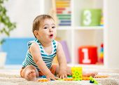 kid boy playing with block toys indoor poster