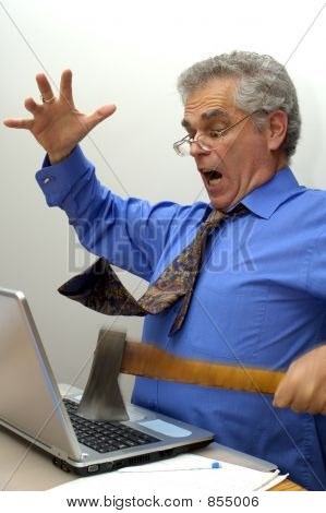An older businessman fed up with his laptop, takes an axe to it. poster