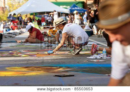 Chalk Artists Draw Halloween Scenes On Street
