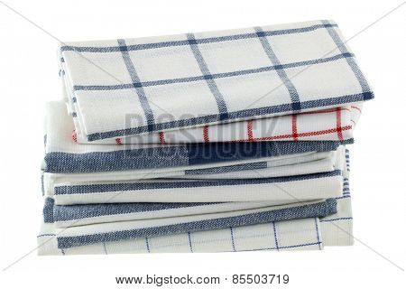 Folded kitchen towels in different patterns, isolated on white