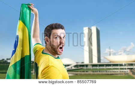 Man holding the Brazilian flag in Brasilia, Brazil